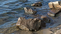 The River Waves Beating Stones at the Beach Stock Footage