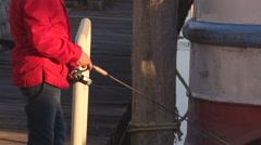 Fisherman on the moore reeling his fishing rod Stock Footage