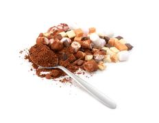 Spoonful of cocoa with toppings for hot chocolate - stock photo