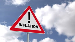 Stock Video Footage of Inflation sign against blue sky