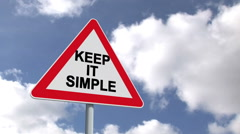 Keep it simple sign against blue sky - stock footage