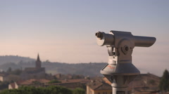 Girl on a terrace looks at the panorama and throuh a spyglass - close up Stock Footage