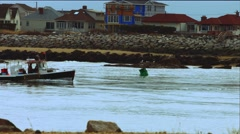 Fishing Boat Coming into Port at Beach During The Winter Stock Footage