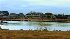 Fishing Boat going by at Beach During The Winter Stock Footage