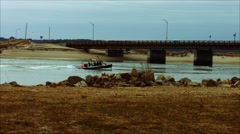 Fishing Boat going Under Bridge at Beach During The Winter Stock Footage