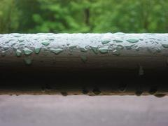 Water droplets on a railing Stock Photos