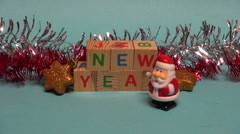 Beautiful Santa Claus toy walking near Christmas New year decorations Stock Footage