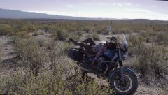 Female biker in desert Stock Footage