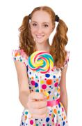 Stock Photo of Redhead young girl with lolipops isolated on white