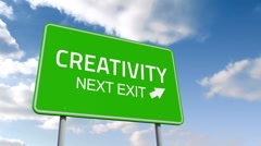 Creativity and next exit road sign over cloudy sky Stock Footage