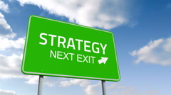 Strategy and next exit road sign over cloudy sky Stock Footage