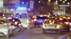 Night at city ambulance stuck in traffic jam trying to make through Stock Footage