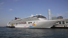 A cruise ship Parks at Victoria Harbour in Hong Kong's Tsim Sha Tsui Stock Footage