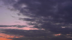 Sunset colored dark clouds timelapse - wide shot Stock Footage