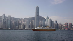 Time Lapse of a cruise ship past IFC at Victoria Harbour Stock Footage