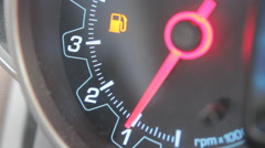 Car fuel gauge going from full to empty Stock Footage