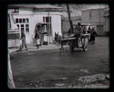Wagon with a donkey in the city, SD vintage video 8mm Stock Footage