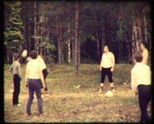 Children and parents playing volleyball, SD vintage video 8mm - stock footage