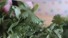 Close up of cilantro chopped with a chef knife Stock Footage