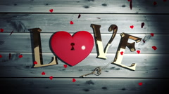 Heart confetti falling on golden love text with heart lock Stock Footage