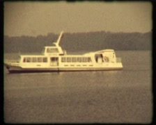 White motorboat on the lake, SD vintage video 8mm Stock Footage