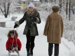 Children on a sledge. Related clips are in my portfolio in 1920x1080. - stock footage