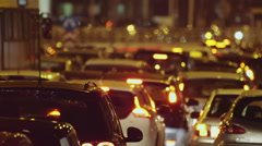 Night traffic jam at city telephoto lens cars grind to a halt on avenue Stock Footage