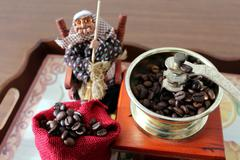 Coffee grinder and Befana Stock Photos