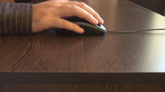 Businessman hand close up holding computer mouse, moving on desk, business shirt Stock Footage