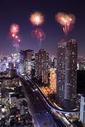 Stock Photo of fireworks celebrating over tokyo cityscape at night
