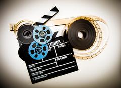 Clapper board and film reels vintage color effect Kuvituskuvat