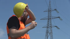 Hard worker electrician at high voltage pole enjoying lunch sandwich, wipe sweat - stock footage