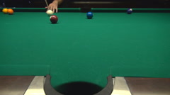 Playing billiards indoor, pool club young man enjoying his hobby, ball in pocket Stock Footage