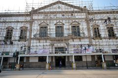 workers repair civic and municipal affairs bureaumore in macau - stock photo