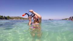 Beautiful girl prepares snorkeling mask for diving, slow motion stock video Stock Footage