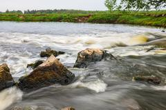 rapid flow of small river - stock photo