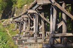 old wood structure of dead railways bridge important landmark and destination - stock photo