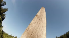 Wood pile stands in a blue sky Stock Footage