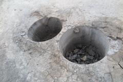 Cylindrical specimens (roadway core specimens) of the asphalt pavement taken Stock Photos