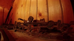 on the background wall of wood wrought old mechanism - stock footage