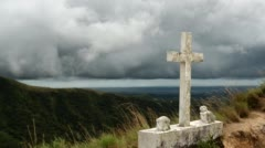 Timelapse: Storm Clouds Passing Over Isolated Stone Cross Monument Stock Footage