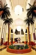 lobby interior of the luxury hotel in night illumination, ajman, uae - stock photo