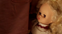 Doll in a girl's hands closeup Stock Footage