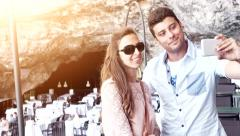 Young Attractive Couple Taking Selfie Picture Snapshot Vacation Cave Restaurant Stock Footage