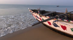 beautiful ornamental wooden boat on Arabian sea beach in Odisha, India - stock footage
