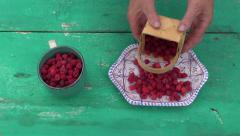Fresh wild raspberry in decorative plate Stock Footage