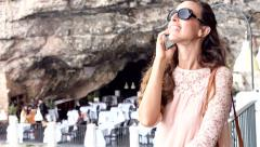 Young Woman Talking On Phone Cafe Restaurant View Rocks Sea Luxury Five Star Stock Footage