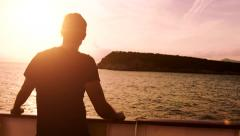 Peace Tranquility Young Man Standing Deck Ship Sunset Ocean Island Cruise Stock Footage