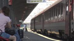 Train station platform view, commuters wait train departure, traveling by train Stock Footage