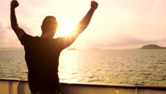 Young Man Travel Adventure Success Happy Joy Arms Outstretched Sun Sunset Ocean Stock Footage